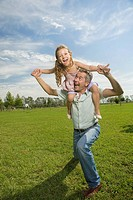 Happy father with daughter on his shoulders