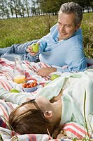 Husband and wife having picnic in park