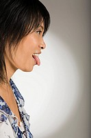 Close-up of a mid adult woman sticking her tongue out