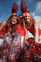 Portrait of three cheerleaders cheering
