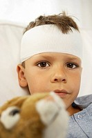Portrait of a boy with a bandage on his forehead