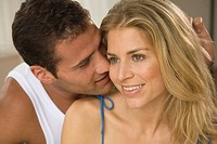 Close-up of a young man kissing a young woman (thumbnail)