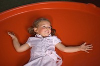 High angle view of a girl lying on a trampoline