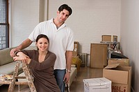 Couple with living room packed for redecorating