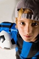 Portrait of a boy holding a soccer ball