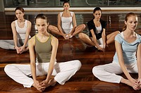 Five young women exercising