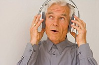 Close-up of a businessman listening to music