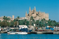 Boats at a harbor with a cathedral in the background, Palma Cathedral, Palma, Majorca, Balearic Islands, Spain