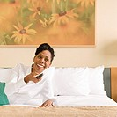 Businesswoman relaxing in hotel room