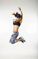 Woman athlete jumps in studio