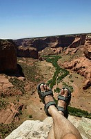 Man´s legs and canyon valley