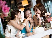 Three Young Playful Women at Cafe