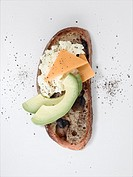 Olive bread topped with cottage cheese, american cheese and melon