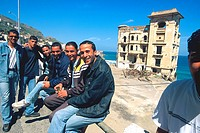 Algiers, men sitting along the road near Miramar