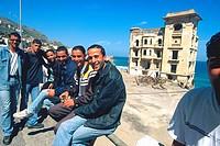 Algiers, men sitting along the road near Miramar