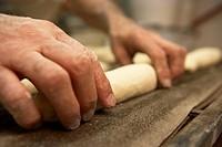 Man kneading dough, close-up of hands