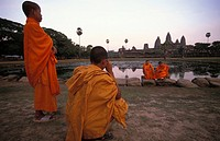 Angkor, monks taking each others pictures at the Angkor Wat temple at sunrise