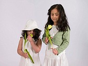 Two girls holding a flower (thumbnail)