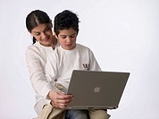 Mother with son holding a laptop