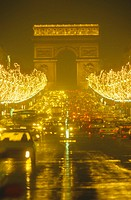 France, Paris, Avenue de Champs-Elysees with Christmas lights at night