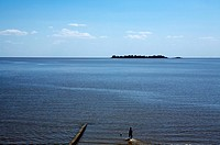 South America, Uruguay, Colonia de Sacramento, silhouette of person by ocean