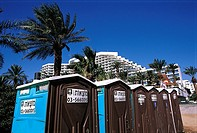 Israel, Eilat, toilet cubicles on the beach