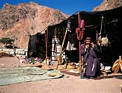 Israel, near Eilat, Negev desert, man in his Bedouin tent