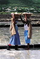 Mauritius, salted marshes, women carrying baskets of salt