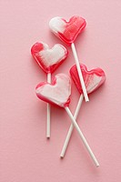 Four heart-shaped lollipops