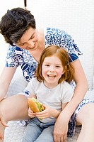Woman and small girl with hot dog
