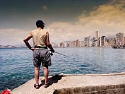 Fishing at Benidorm, Benidorm beach, Alicante province, Spain