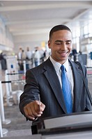 Man using express check-in service at airport, close-up