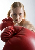 Young woman boxing, portrait