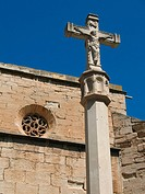Stone cross and church. Nonaspe. Zaragoza province. Spain