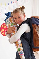 Date of first school day, classroom, child, girls, school satchels, school bag, hold, smile, cheerful, with pride, half mirror image,