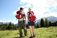 Couple, mountains, meadow, backpack,
