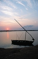 Local Sailboat Docked at Shore at Sunset  Rovuma River, Mozambican / Tanzanian Border