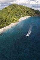 Boat Cruising the Shore of a Pristine Island  Seychelles, Indian Ocean