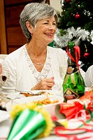 Mature Woman Having Christmas Lunch  Cape Town, Western Cape Province, South Africa