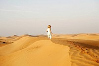Baby Girl 2-4 yrs Standing on a Desert Dune  Dubai, United Arab Emirates, Middle East