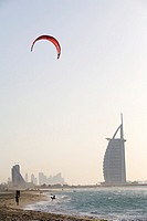 Kite Surfer Standing on the Shoreline with Burj Al Arab in the Background  Dubai, United Arab Emirates