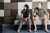 Young couple sitting and relaxing on couch