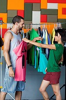 Young couple selecting clothes