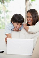 Mother and son looking at laptop computer