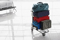 Suitcases on baggage cart