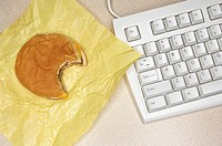 Cheeseburger and computer keyboard
