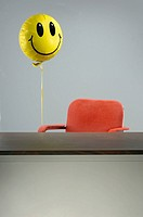 Balloon tied to office chair