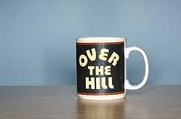 Over the hill coffee cup