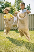 Children having potato sack race