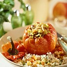 Stuffed red pepper with mince filling on rice